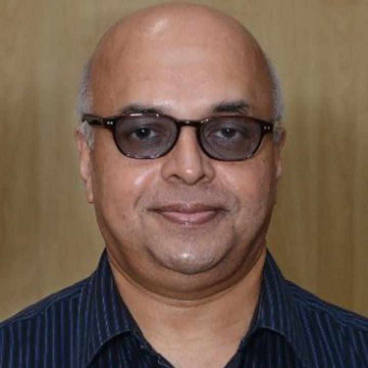 Shri Tom Jose IA